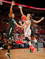 Ohio State Buckeyes guard Cait Craft (13) throws up a shot that is blocked by Michigan State Spartans center Madison Williams (40) during the first half of their NCAA basketball game at Value City Arena in Columbus, Ohio on January 26, 2014.  (Dispatch photo by Kyle Robertson)