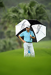 TAIPEI, TAIWAN - NOVEMBER 19:  John Gould of England shelters from the rain under an umbrella on the 6th hole during day two of the Fubon Senior Open at Miramar Golf & Country Club on November 19, 2011 in Taipei, Taiwan.  Photo by Victor Fraile / The Power of Sport Images