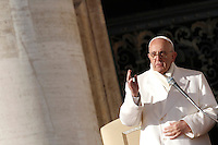 Papa Francesco benedice i fedeli al termine dell'udienza generale del mercoledi' in Piazza San Pietro, Citta' del Vaticano, 30 dicembre 2015.<br /> Pope Francis delivers his blessing to faithful at the end of his weekly general audience in St. Peter's Square at the Vatican, 30 December 2015.<br /> UPDATE IMAGES PRESS/Isabella Bonotto<br /> <br /> STRICTLY ONLY FOR EDITORIAL USE