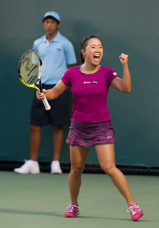 KEY BISCAYNE, FL - March 26: Kurumi Nara (JPN)celebrates after defeating Caroline Garcia (FRA) 63 76(9) to advance to the 3rd round of the 2015 Miami Open at Key Biscayne, FL.  Photographer Andrew Patron - CameraSport/BigShots<br /> <br /> Tennis - 2015 Miami Open presented by Itau - Crandon Park Tennis Center - Key Biscayne, Florida - USA - Day 4, Thursday 26th March 2015<br /> <br /> &copy; CameraSport - 43 Linden Ave. Countesthorpe. Leicester. England. LE8 5PG - Tel: +44 (0) 116 277 4147 - admin@camerasport.com - www.camerasport.com