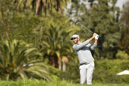 19th Februaru 2017, Pacific Palisades, CA, USA;  Dustin Johnson hits from the fourth hole fairway during the final round of the Genesis Open golf tournament at the Riviera Country Club on February 19, 2017.