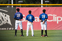 Missoula Osprey outfielders Kristian Robinson (18), Alek Thomas (19), and David Sanchez (16) stand for the national anthem before a Pioneer League game against the Grand Junction Rockies at Ogren Park Allegiance Field on August 21, 2018 in Missoula, Montana. The Missoula Osprey defeated the Grand Junction Rockies by a score of 2-1. (Zachary Lucy/Four Seam Images)