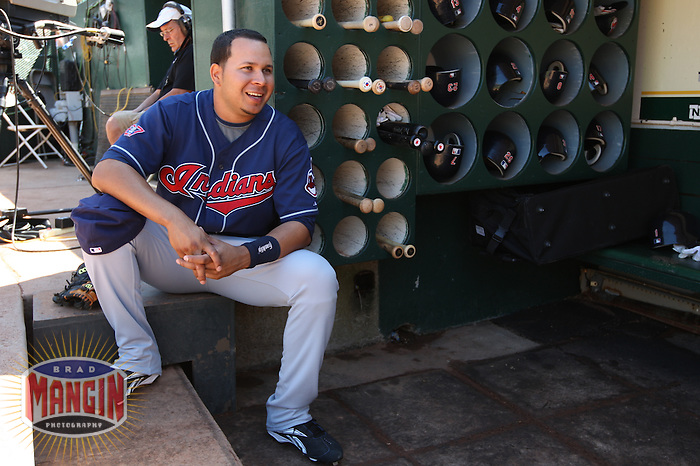 OAKLAND, CA - SEPTEMBER 20:  Jhonny Peralta #2 of the Cleveland Indians gets ready in the dugout before the game against the Oakland Athletics at the Oakland-Alameda County Coliseum on September 20, 2009 in Oakland, California. Photo by Brad Mangin