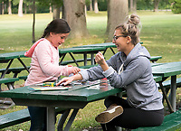 "Brianne Haslip, of Sarnia has been a Big Sister to ??? since February this year and finds the experience Awesome. ""I love it,"" she said while assembling a puzzle at Canatara Park. The pair were also colouring and applying glitter to their works of art."