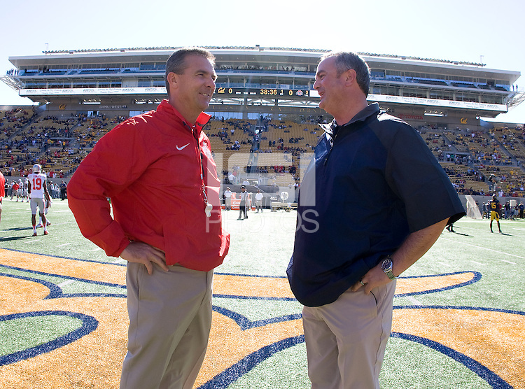 California head coach Sonny Dykes talks with Ohio State head coach Urban Meyer before the game at Memorial Stadium in Berkeley, California on September 14th, 2013.  Ohio State defeated California, 52-34.