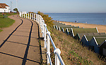 Beach huts, seafront promenade path and sand from Gun Hill, Southwold, Suffolk, England