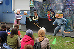 """Arm-of-the-Sea Theater, presenting their new play """"DIRT"""" that tells the story of how Garlic came to the area, at the 27th Annual Hudson Valley Garlic Festival, held in Cantine Memorial Field, in Saugerties, NY, on Saturday, October 1, 2016. Photo by Jim Peppler; Copyright Jim Peppler 2016."""