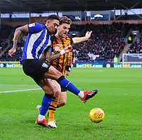 Sheffield Wednesday's Liam Palmer vies for possession with Hull City's Chris Martin<br /> <br /> Photographer Chris Vaughan/CameraSport<br /> <br /> The EFL Sky Bet Championship - Hull City v Sheffield Wednesday - Saturday 12th January 2019 - KCOM Stadium - Hull<br /> <br /> World Copyright &copy; 2019 CameraSport. All rights reserved. 43 Linden Ave. Countesthorpe. Leicester. England. LE8 5PG - Tel: +44 (0) 116 277 4147 - admin@camerasport.com - www.camerasport.com