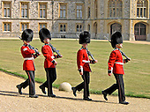 Guards return to their barracks after the changing of the guard at Windsor Castle in Windsor, Sunday, August 10, 2003.  Queen Elizabeth II makes her primary residence here during most of the year.  It is used as a venue for state visits.