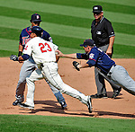 6 September 2009: Cleveland Indians' outfielder Michael Brantley is called safe at second base as Minnesota Twins first baseman Michael Cuddyer is unable to hold onto the ball in a rundown play at Progressive Field in Cleveland, Ohio. The Indians defeated the Twins 3-1 to take the rubber match of their three-game weekend series. Mandatory Credit: Ed Wolfstein Photo