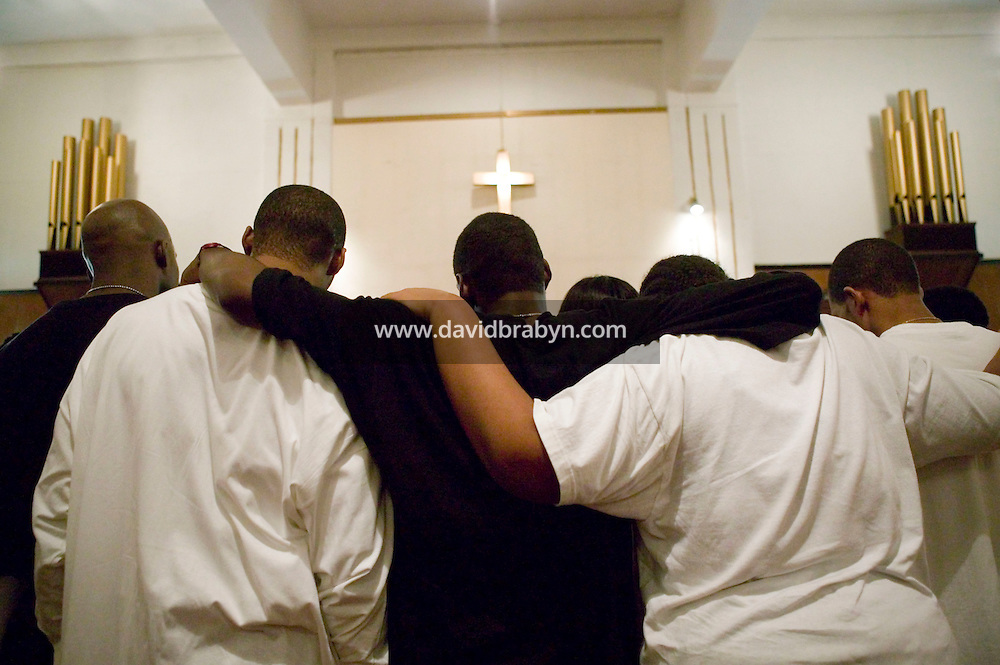 New York, USA - Teenagers attend mass at the Greater Hood Memorial AME Zion Church, home of the Hip-Hop Church, in Harlem, New York, USA, 24 February 2005. Photo Credit: David Brabyn.