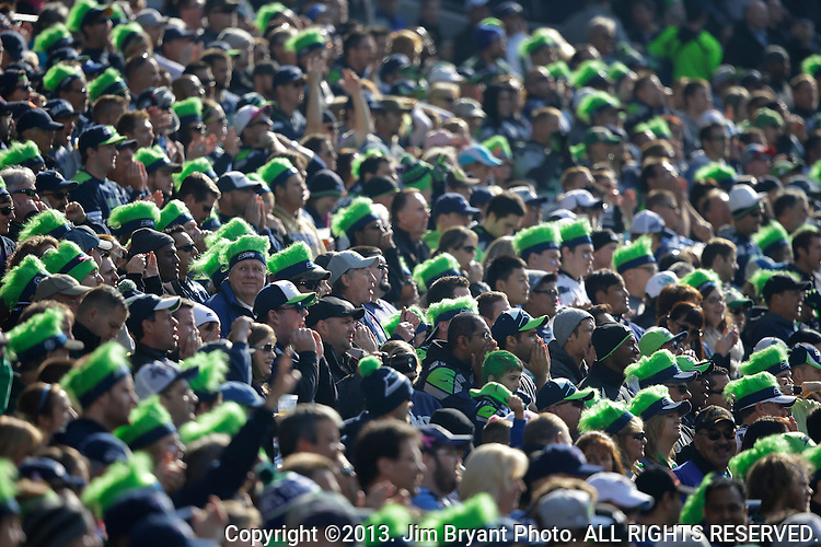Seattle Seahawks fans cheer against the Tennessee Titians at CenturyLink Field in Seattle, Washington on October 13, 2013. The Seattle Seahawks beat the Titians  20-13.   ©2013. Jim Bryant Photo. All Rights Reserved.