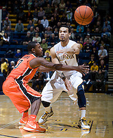 Justin Cobbs of California passes the ball during the game against Oregon State Beavers at Haas Pavilion in Berkeley, California on January 31st, 2013.  California defeated Oregon State, 71-68.