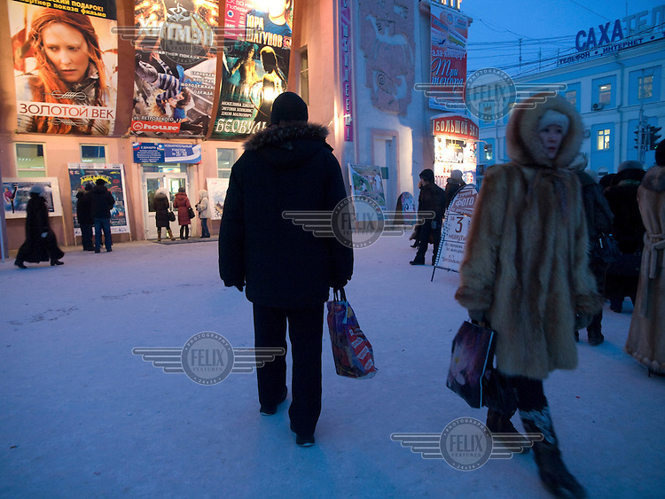 Evening street scene in front of a cinema in the city centre of Yakutsk. .