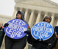 January 23, 2012  (Washington, DC)  Pro-choice demonstrators held signs in front of the U.S. Supreme Court as thousands of pro-life supporters rallied in the street.   (Photo by Don Baxter/Media Images International)