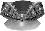"""Grand Central Flight"" Black and White Panoramic Grand Central Terminal Manhattan New York.  I was very fortunate to be able to schedule an hour on the main floor of the Terminal during such a special year. It was the 100th Year Anniversary for the building.  I wanted to try and capture the light coming through the three windows like in the famous classic old photograph taken when the building was first constructed. When I applied for my photography permit(only one photographer allowed on the floor at a time) I was informed that the light to the windows is blocked by the tall buildings that were added after the Terminal's construction. They did however add the large numbers in the windows to celebrate the 100th Anniversary. I have several photographs that have the ceiling with the constellations in view and the incredible chandeliers that hang in surrounding rooms just off the main floor.  I put my camera on the floor and used my remote to fire the shutter to compose the ceiling with the arches of the windows in view. I also have a couple of panoramic photographs that have transparent travelers in motion moving through and cover the entire width of the main floor."