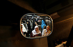 Family members of Palestinian prisoners on their way to visit their relatives jailed in Israel sit in a bus before it leaves Gaza City July 16, 2012. Israel on Monday allowed Palestinian families from the Gaza Strip to visit their jailed relatives for the first time in five years, Israeli officials said, under a deal that ended a prisoners' hunger strike. Photo by Eyad Al Baba