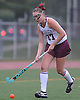 Caroline Munn #27 of Garden City moves the ball upfield during a Nassau County Conference I varsity field hockey match against Baldwin at Garden City High School on Friday, Sept. 30, 2016. Garden City won by a score of 7-0.