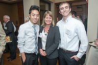 From left, Shane Moore '15, Lisa Link P'18 and Malcolm Clayton '14. Occidental College hosts the Scholarship Appreciation Reception, February 13, 2014 in Dumke Commons of Swan Hall.  (Photo by Marc Campos, Occidental College Photographer)