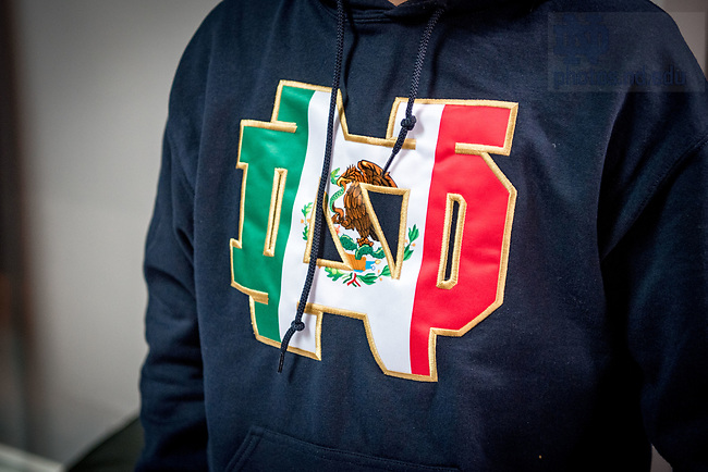 October 30, 2017; A student wears a Notre Dame monogram in the style of the flag of Mexico at an on-campus event celebrating Dia de Los Muertos. (Photo by Matt Cashore/University of Notre Dame)