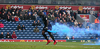 Oldham Athletic's goalkeeper Johnny Placide collects smoke bombs thrown onto the pitch<br /> <br /> Photographer Stephen White/CameraSport<br /> <br /> The EFL Sky Bet League One - Blackburn Rovers v Oldham Athletic - Saturday 10th February 2018 - Ewood Park - Blackburn<br /> <br /> World Copyright &copy; 2018 CameraSport. All rights reserved. 43 Linden Ave. Countesthorpe. Leicester. England. LE8 5PG - Tel: +44 (0) 116 277 4147 - admin@camerasport.com - www.camerasport.com