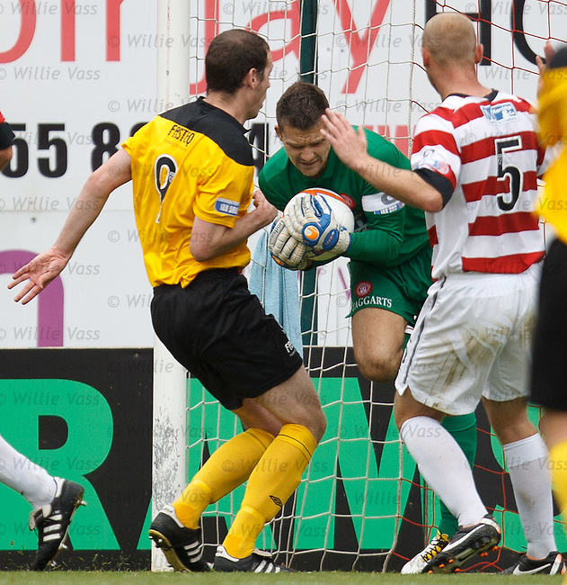 Tomas Cerny grabs the ball from the onrushing Kenny Deuchar