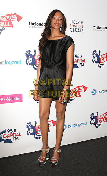 SHONTELLE (Shontelle Layne).Capital FM Summertime Ball at the Emirates Stadium, London, England..June 7th, 2009.full length black jumpsuit playsuit shorts top silk satin platform shoes sandals clear plastic .CAP/ROS.©Steve Ross/Capital Pictures.