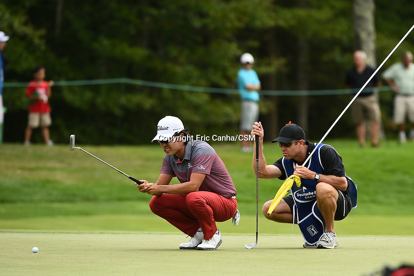 August 29, 2014 -  Norton, Mass. -  Kevin Na studies the 7th green with his caddy during the first round of the PGA Deutsche Bank Championship held at the Tournament Players Club in Norton Massachusetts. Eric Canha/CSM