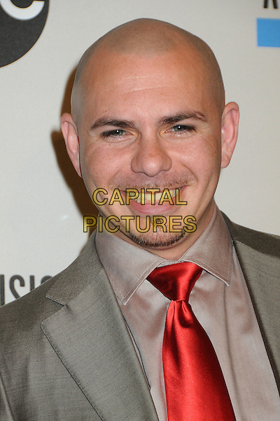 Pitbull (Armando Christian Perez).2011 American Music Awards Nominee Press Conference held at the JW Marriott LA Live Hotel, Los Angeles, California, USA..October 11th, 2011.headshot portrait goatee facial hair red tie grey gray suit  smiling .CAP/ADM/BP.©Byron Purvis/AdMedia/Capital Pictures.