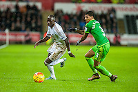 Modou Barrow of Swansea and Patrick van Aanholt of Sunderland in action during the Barclays Premier League match between Swansea City and Sunderland played at the Liberty Stadium, Swansea  on  January the 13th 2016