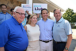 Massapequa, New York, USA. August 5, 2018. L-R, NY Senator JOHN BROOKS; LIUBA GRECHEN SHIRLEY, Congressional candidate for NY 2nd District; Governor ANDREW CUOMO; and DAVID GUGERY, the Democratic Commissioner of Nassau County Board of Elections; pose during opening of joint campaign office for the 2 Long Islander candidates, aiming for a Democratic Blue Wave in November midterm elections.