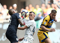 Calcio, Serie A: Inter Milano-Parma, Giuseppe Meazza stadium, September 15, 2018.<br /> Parma's goalkeeper Luigi Sepe (l) in action with Inter's Ivan Perisic (c) and Parma's Riccardo Gagliolo (r)  during the Italian Serie A football match between Inter and Parma at Giuseppe Meazza (San Siro) stadium, September 15, 2018.<br /> UPDATE IMAGES PRESS/Isabella Bonotto