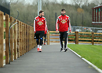 Monday 25 November 2014<br /> Pictured L-R: Angel Rangel and Jordi Amat walking on the path towards the gym<br /> Re: Swansea City FC training at the club's Fairwood Training Ground in the outskirts of Swansea, south Wales, UK.