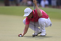 Haotong Li (CHN) on the 18th green during the 3rd round of the DP World Tour Championship, Jumeirah Golf Estates, Dubai, United Arab Emirates. 17/11/2018<br /> Picture: Golffile | Fran Caffrey<br /> <br /> <br /> All photo usage must carry mandatory copyright credit (&copy; Golffile | Fran Caffrey)