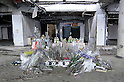 "Minamisanriku, Miyagi, Japan - The flowers and drinks dedicated to dead people at public Shizugawa hospital in Minamisanriku, one year after the tsunami. The Latin group of volunteers ""Todos con Japon"" visits Miyagi area during this Golden Week."