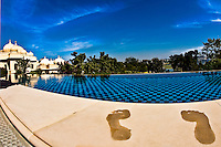 Foot prints on the warm sandstone of the poolside room at the Oberoi Udaivilas. (Photo by Matt Considine - Images of Asia Collection)