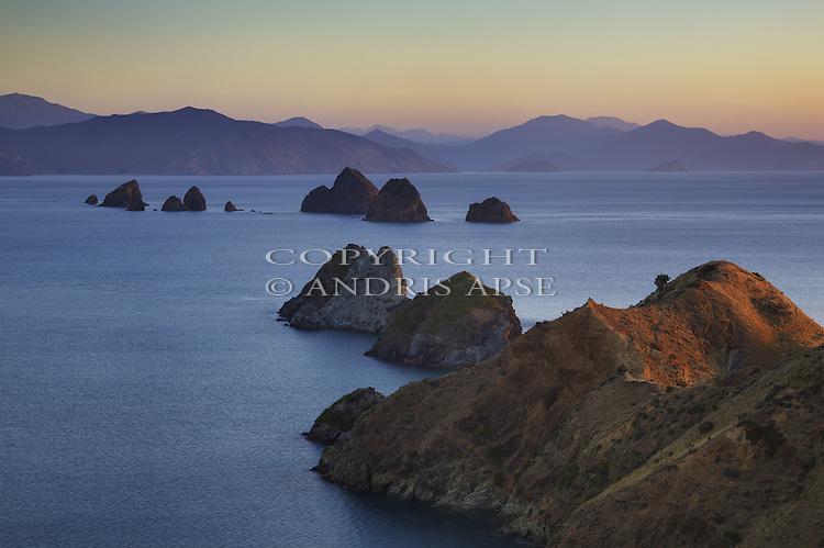 The Paddock Rocks at sunset. D'Urville Island. Marlborough Region. New Zealand.
