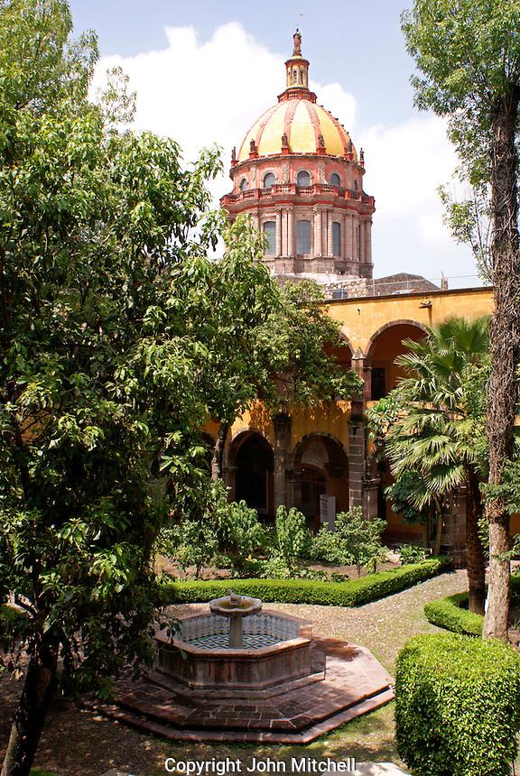 Dome of Templo de la Concepcion church and interior of the courtyard of  the Escuela de Bellas Artes or El Nigromante in San Miguel de Allende, Mexico. San Miguel de Allende is a UNESCO World Heritage Site.