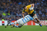 Rob Simmons of Australia is tackled by Ramiro Herrera of Argentina during the Semi Final of the Rugby World Cup 2015 between Argentina and Australia - 25/10/2015 - Twickenham Stadium, London<br /> Mandatory Credit: Rob Munro/Stewart Communications