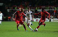 Pictured: Ben Davies of Swansea (C) against Martin Skrtel (L) and Kolo Toure (R) of Liverpool.<br /> Monday 16 September 2013<br /> Re: Barclay's Premier League, Swansea City FC v Liverpool at the Liberty Stadium, south Wales.