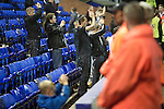 Home team supporters in the Bebington Kop applauding their team off the pitch at Prenton Park as Tranmere Rovers lose to Stoke City in a Capital One Cup third round match. The Capital One cup was formerly known as the League Cup and was competed for by all 92 English Premier League and Football League clubs. Visitors Stoke City won the match 2-0, watched by a crowd of 5,559 spectators.