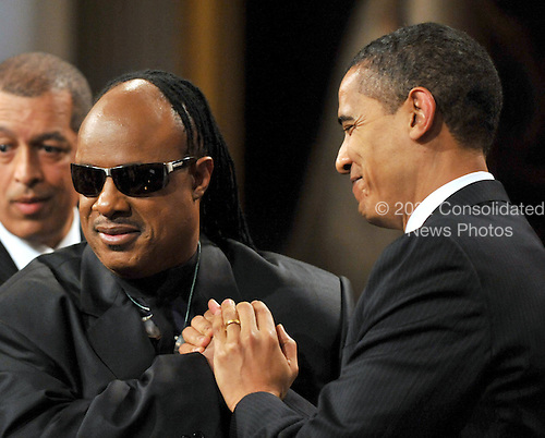 """Washington, D.C. - February 25, 2009 -- United States President Barack Obama shakes hands with Stevie Wonder as he and first lady Michelle Obama host """"Stevie Wonder In Performance at the White House: The Library of Congress Gershwin Prize"""" to showcase an evening of celebration at the White House in honor of musician Stevie Wonder's receipt of the Library of Congress Gershwin Prize for Popular Song in the East Room of the White House in Washington, D.C. on Wednesday, February 25, 2009..Credit: Ron Sachs / Pool via CNP"""