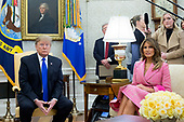 US President Donald J. Trump (L) and US First Lady Melania Trump (R) attend a meeting with their Colombian counterparts in the Oval Office of the White House in Washington, DC, USA, 13 February 2019. President Trump met with President of Colombia Ivan Duque to discuss economic policies, combatting narcotics and the current situation in Venezuela.<br /> Credit: Michael Reynolds / Pool via CNP