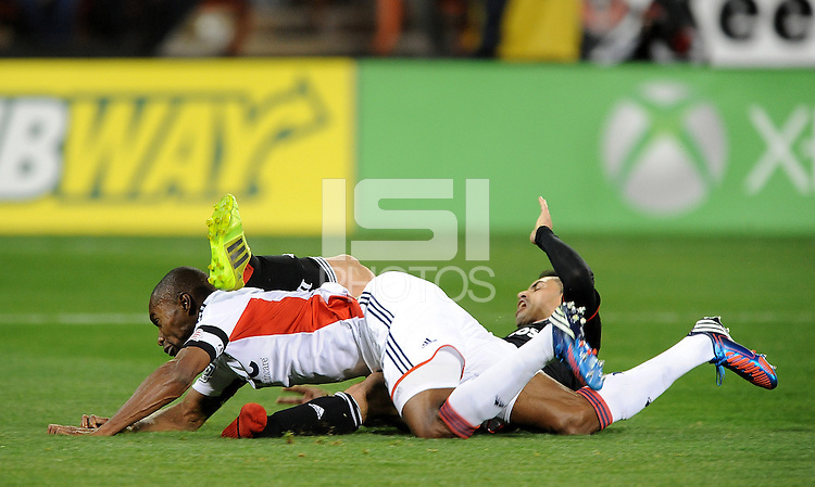 Washington D.C. - April 5, 2014:  Fabian Espindola of D.C. United gets tackle inside the box by Jose Goncalves from the New England Revolution. D.C. United defeated 2-0 the New England Revolution during a Major League Soccer match for the 2014 season at RFK Stadium.
