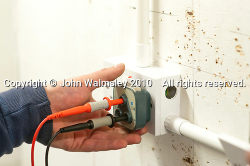Student electrician testing a domestic socket, Able Skills, Dartford, Kent.