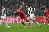 FUSSBALL  CHAMPIONS LEAGUE  VIERTELFINALE  RUECKSPIEL  2012/2013      Juventus Turin - FC Bayern Muenchen        10.04.2013 Bastian Schweinsteiger (li, FC Bayern Muenchen) gegen Andrea Pirlo (re, Juventus Turin)