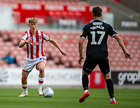 27th June 2020; Bet365 Stadium, Stoke, Staffordshire, England; English Championship Football, Stoke City versus Middlesbrough; Sam Clucas of Stoke City takes on Paddy McNair of Middlesbrough