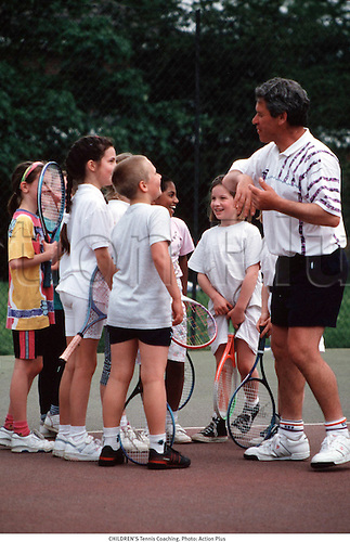 A group of young children listen to their tennis coach. Photo: Action Plus...1998.teach teaching teacher teachers.coach coaches coaching.tuition.tutor.instructor instruction learn learning.trainer training.child.children.kids.boy.boys.infant.infants.Youngster.Youngsters.girls.girl.female.lesson learn learning.player