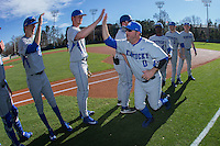 Kentucky Wildcats assistant coach Roland Fanning (0) high fives his team during player introductions prior to the game against the North Carolina Tar Heels at Boshmer Stadium on February 17, 2017 in Chapel Hill, North Carolina.  The Tar Heels defeated the Wildcats 3-1.  (Brian Westerholt/Four Seam Images)