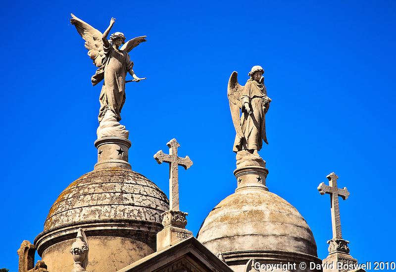 Sculptures decorate the crypts in the Cementario de la Recoleta in Buenos Aires, Argentina.